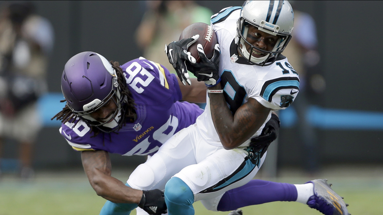 Carolina Panthers' Ted Ginn (19) is tackled by Minnesota Vikings' Trae Waynes (26) in the first half of an NFL football game in Charlotte, N.C., Sunday, Sept. 25, 2016.