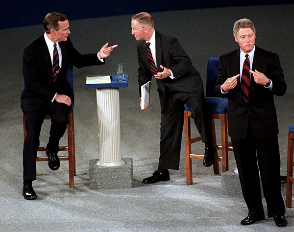 "<div class=""meta image-caption""><div class=""origin-logo origin-image ap""><span>AP</span></div><span class=""caption-text"">President George H. W. Bush talks with Ross Perot as Democratic candidate Bill Clinton stands aside at the end of their second presidential debate in Richmond, VA. (Marcy Nighswander/AP)</span></div>"