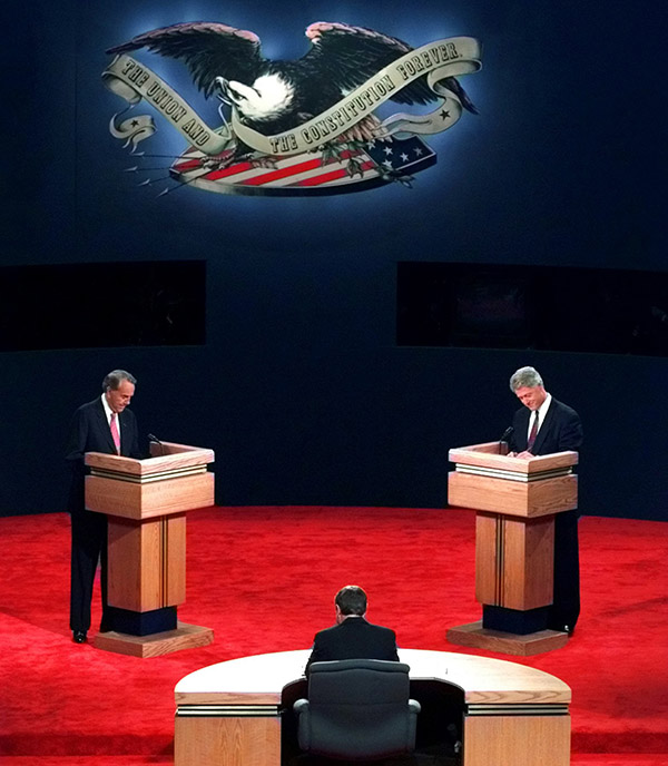 "<div class=""meta image-caption""><div class=""origin-logo origin-image ap""><span>AP</span></div><span class=""caption-text"">President Clinton and Bob Dole prepare for opening remarks at the presidential debate at the Bushnell Theater in Hartford, CT, Sunday Oct. 6, 1996. (Charles Krupa/AP)</span></div>"