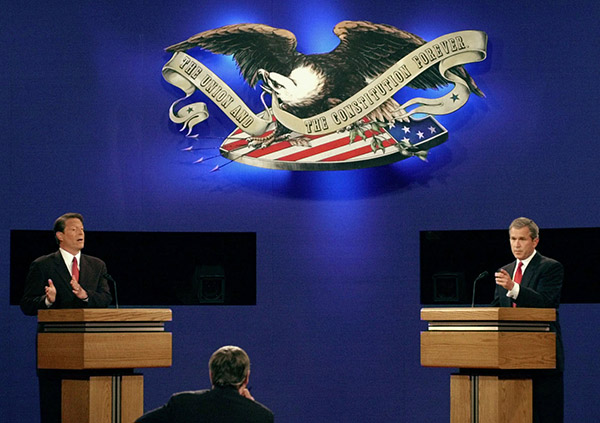 "<div class=""meta image-caption""><div class=""origin-logo origin-image ap""><span>AP</span></div><span class=""caption-text"">Republican presidential candidate George W. Bush and Democratic presidential candidate Al Gore debate during the first presidential debate Tuesday, Oct. 3, 2000. (Ron Edmonds/AP)</span></div>"