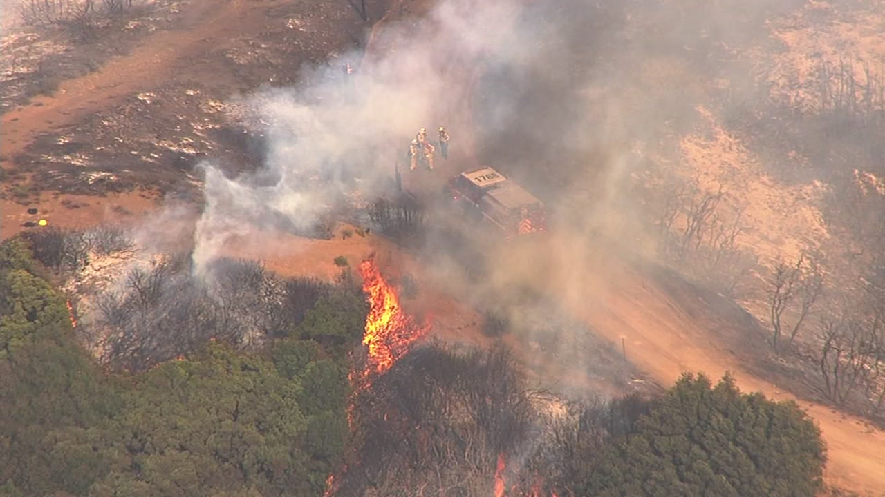 "<div class=""meta image-caption""><div class=""origin-logo origin-image none""><span>none</span></div><span class=""caption-text"">A fast-growing brush fire burns on Loma Prieta in the Santa Cruz Mountains on Monday, September 26, 2016. (Photo submitted to KGO-TV by @Hendo1988/Twitter)</span></div>"