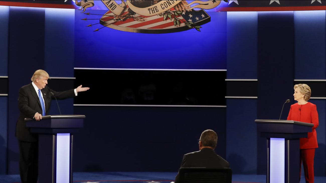 Republican presidential nominee Donald Trump gestures toward Democratic presidential nominee Hillary Clinton during the presidential debate in N.Y. on Sept. 26, 2016. (AP Photo)