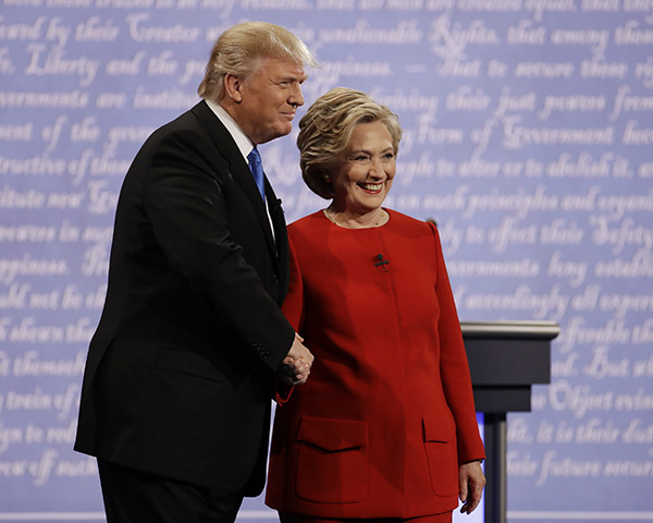 "<div class=""meta image-caption""><div class=""origin-logo origin-image ap""><span>AP</span></div><span class=""caption-text"">Democratic presidential nominee Hillary Clinton shakes hands with Republican presidential nominee Donald Trump during the presidential debate at Hofstra University. (Julio Cortez/AP)</span></div>"