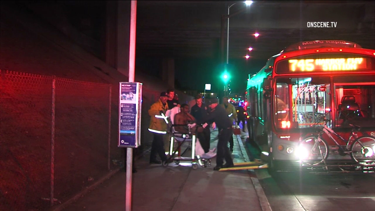 A man is wheeled from a Metro bus following a stabbing attack in South Los Angeles on Monday, Sept. 26, 2016.