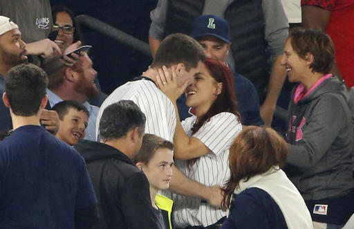 "<div class=""meta image-caption""><div class=""origin-logo origin-image ap""><span>AP</span></div><span class=""caption-text"">Andrew Fox and Heather Terwilliger embrace after getting engaged during a baseball game between the New York Yankees and the Boston Red Sox in New York, Tuesday, Sept. 27, 2016. (AP Photo/Kathy Willens)</span></div>"