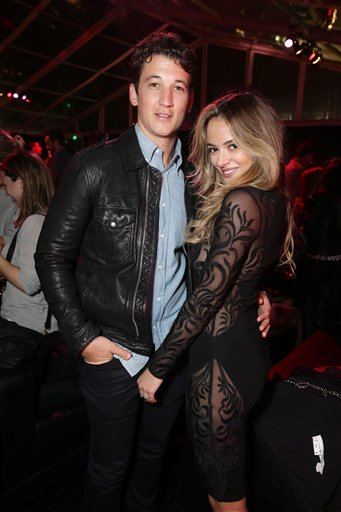 <div class='meta'><div class='origin-logo' data-origin='none'></div><span class='caption-text' data-credit='Eric Charbonneau/Invision/AP'>Exclusive - Miles Teller and Keleigh Sperry seen at Los Angeles World Premiere of New Line Cinema's and Metro-Goldwyn-Mayer Pictures' 'Creed'</span></div>