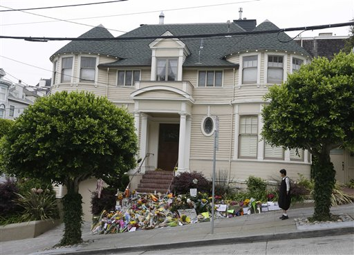 <div class='meta'><div class='origin-logo' data-origin='AP'></div><span class='caption-text' data-credit='AP Photo/Eric Risberg'>A woman stops to look at a makeshift memorial for actor Robin Williams outside a home which was used in the filming of the movie &#34;Mrs. Doubtfire.&#34;</span></div>