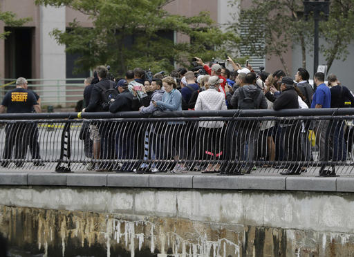 "<div class=""meta image-caption""><div class=""origin-logo origin-image none""><span>none</span></div><span class=""caption-text"">Onlookers gather near the Hoboken Terminal following a train crash, Thursday, Sept. 29, 2016, in Hoboken, N.J. (AP)</span></div>"