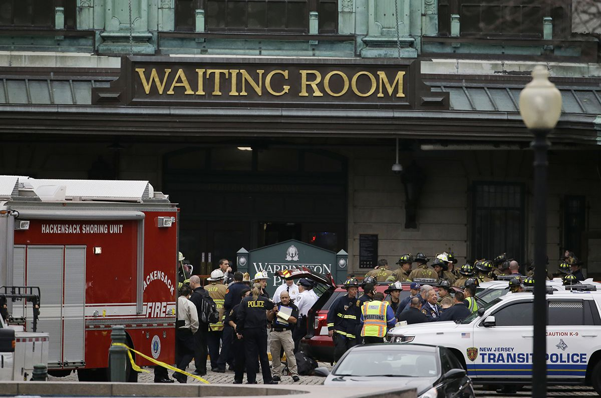 <div class='meta'><div class='origin-logo' data-origin='AP'></div><span class='caption-text' data-credit='AP Photo/Julio Cortez'>Emergency officials stand outside of the Hoboken Terminal following a train crash, Thursday, Sept. 29, 2016, in Hoboken, N.J.</span></div>