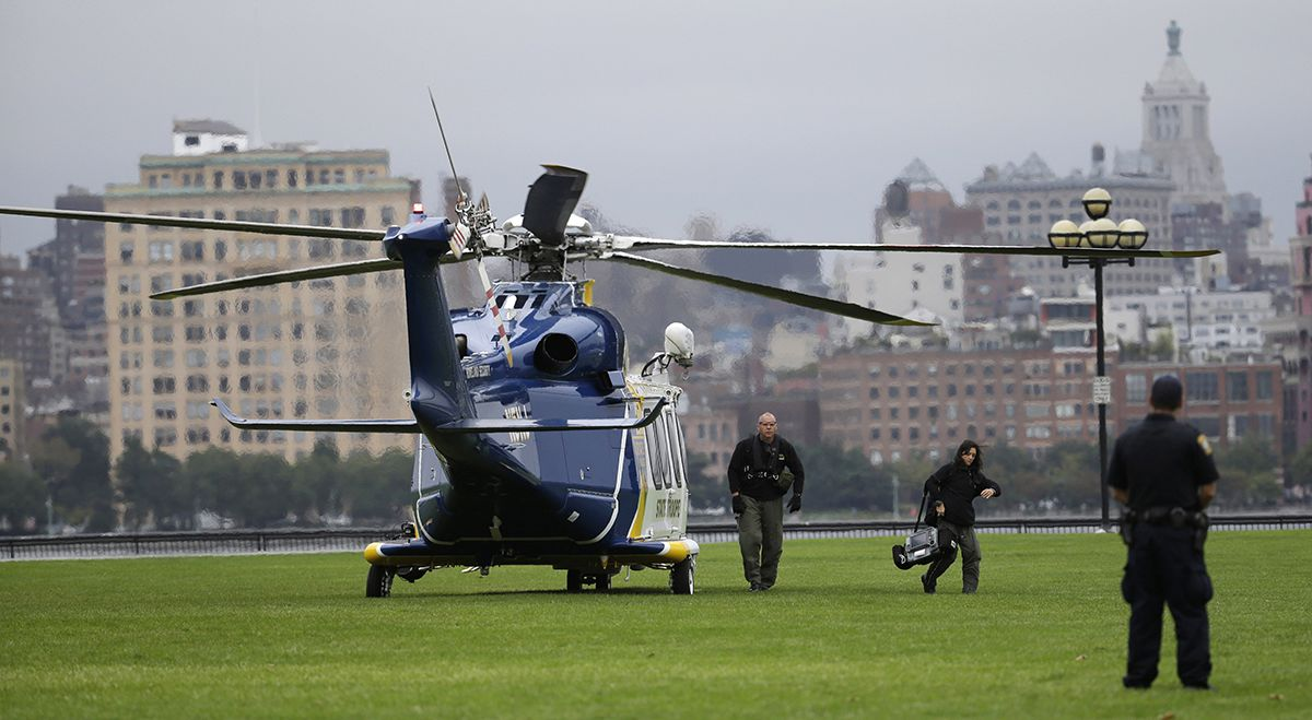"<div class=""meta image-caption""><div class=""origin-logo origin-image ap""><span>AP</span></div><span class=""caption-text"">Emergency officials arrive by helicopter at Pier A Park near the Hoboken Terminal following a train crash, Thursday, Sept. 29, 2016, in Hoboken, N.J. (AP Photo/Julio Cortez)</span></div>"
