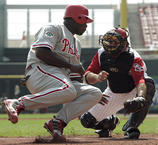 <div class='meta'><div class='origin-logo' data-origin='AP'></div><span class='caption-text' data-credit='AP Photo/Al Behrman'>Philadelphia Phillies baserunner Ryan Howard, left, is safe at home after Cincinnati Reds catcher Corky Miller, right, had dropped the ball in the second inning, Sept. 15, 2004.</span></div>