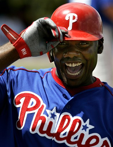 "<div class=""meta image-caption""><div class=""origin-logo origin-image ap""><span>AP</span></div><span class=""caption-text"">Philadelphia Phillies Ryan Howard smiles as he yells to teammates while walking back to the dugout after his second inning solo home run, Tuesday March 14, 2006. (AP Photo/Charles Krupa)</span></div>"