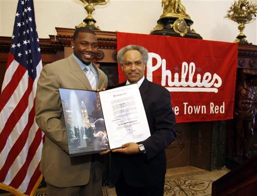 <div class='meta'><div class='origin-logo' data-origin='AP'></div><span class='caption-text' data-credit='AP Photo/Matt Rourke'>Phillies first baseman Ryan Howard, left, the 2005 National League Rookie of the Year, stands for photographs with Mayor John Street at Philadelphia City Hall, March 28, 2006.</span></div>