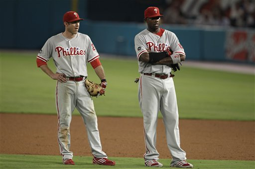 "<div class=""meta image-caption""><div class=""origin-logo origin-image ap""><span>AP</span></div><span class=""caption-text"">Philadelphia Phillies second baseman Chase Utley, left, and first baseman Ryan Howard wait for a pitching change in Miami, Tuesday, Sept. 14, 2010. (AP Photo/Lynne Sladky)</span></div>"