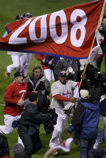 <div class='meta'><div class='origin-logo' data-origin='AP'></div><span class='caption-text' data-credit='AP Photo/Julie Jacobson'>Philadelphia Phillies' Ryan Howard carries a 2008 banner after the team's victory in Game 5 of the baseball World Series in Philadelphia, Wednesday, Oct. 29, 2008.</span></div>