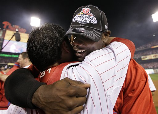 "<div class=""meta image-caption""><div class=""origin-logo origin-image ap""><span>AP</span></div><span class=""caption-text"">Ryan Howard, right, hugs Carlos Ruiz after winning Game 5 of the National League Championship series against the Los Angeles Dodgers, Oct. 21, 2009. (AP Photo/David J. Phillip)</span></div>"