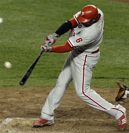 "<div class=""meta image-caption""><div class=""origin-logo origin-image ap""><span>AP</span></div><span class=""caption-text"">Ryan Howard hits a two-run home run during the sixth inning of Game 6 of the Major League Baseball World Series against the New York Yankees Nov. 4, 2009, in New York. (AAP Photo/Kathy Willens)</span></div>"