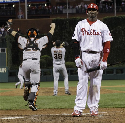<div class='meta'><div class='origin-logo' data-origin='AP'></div><span class='caption-text' data-credit='AP Photo/David J. Phillip'>The San Francisco Giants rush the field as Ryan Howard stands at home after the ninth inning of Game 6 of baseball's National League Championship Series Sunday, Oct. 24, 2010</span></div>