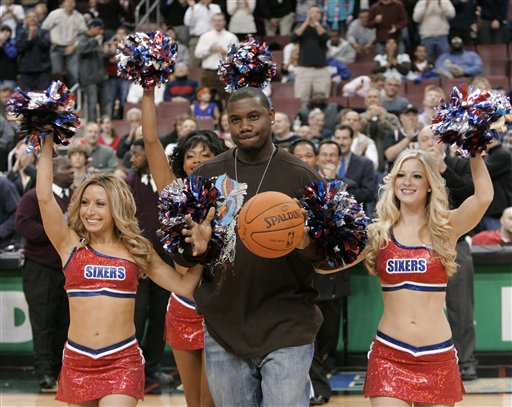 "<div class=""meta image-caption""><div class=""origin-logo origin-image ap""><span>AP</span></div><span class=""caption-text"">Philadelphia Phillies first baseman and National League MVP Ryan Howard is escorted by Philadelphia 76ers cheerleaders, Nov. 21, 2006, in Philadelphia. (AP Photo/George Widman)</span></div>"