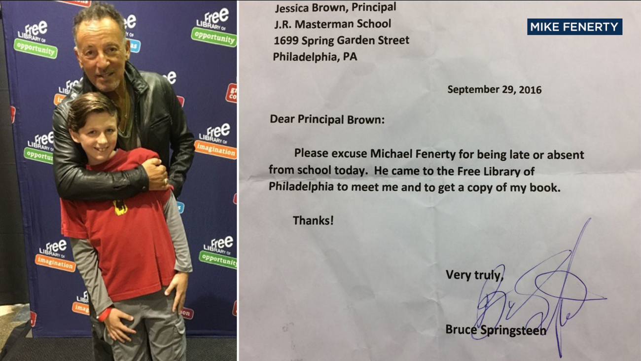 Michael Fenerty of Philadelphia poses for a photo with Bruce Springsteen, who signed a note excusing the fifth-grader from a school absence.