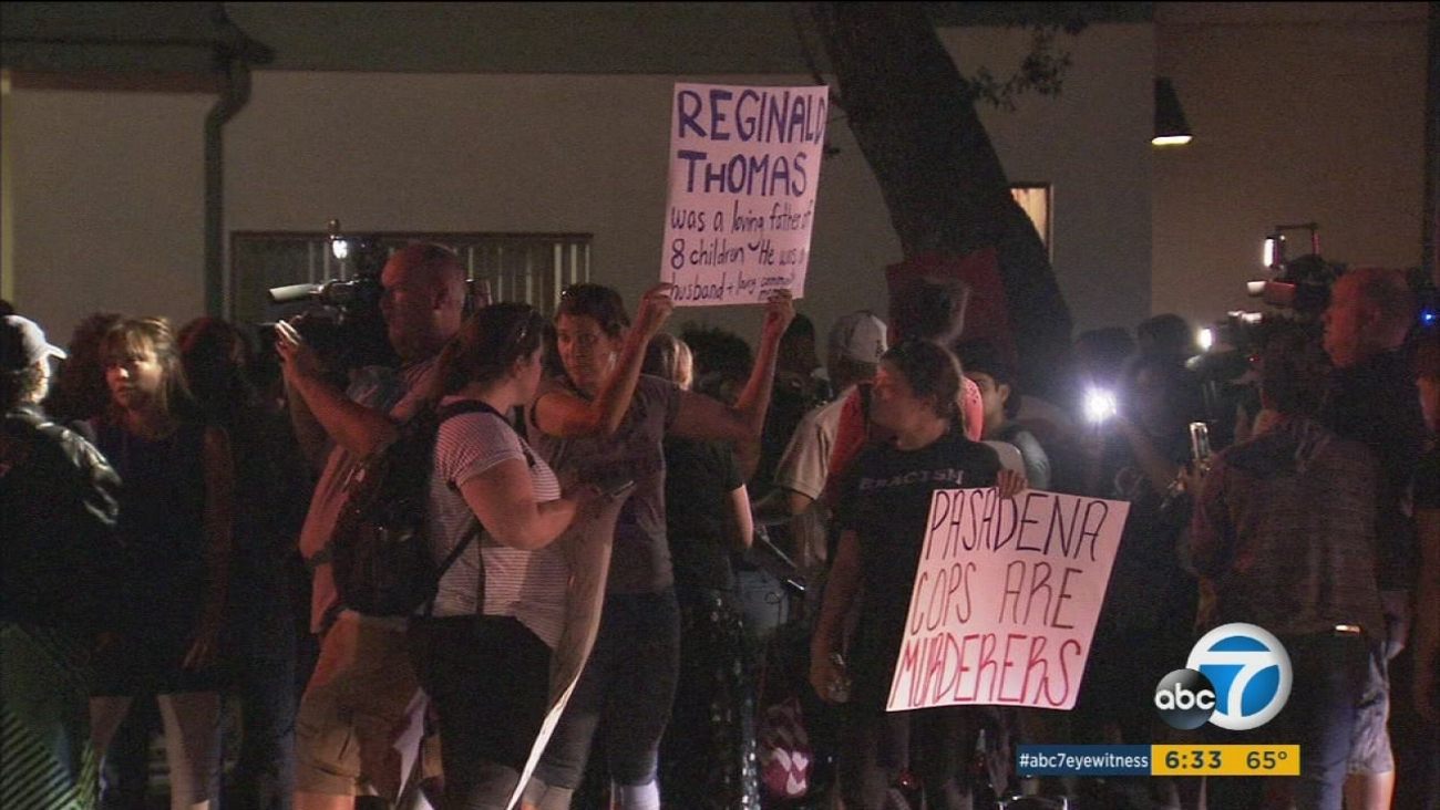 Community members gather to protest the death of an African-American man, who died after being tased by police in Pasadena.