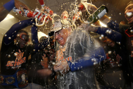 "<div class=""meta image-caption""><div class=""origin-logo origin-image ap""><span>AP</span></div><span class=""caption-text"">New York Mets manager Terry Colllins is doused with champagne and beer in the clubhouse after the Mets secured a wild card playoff spot. (AP)</span></div>"