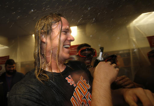 "<div class=""meta image-caption""><div class=""origin-logo origin-image ap""><span>AP</span></div><span class=""caption-text"">New York Mets pitcher Noah Syndergaard is doused with champaign in the clubhouse after the Mets secured a wild card playoff spot. (AP)</span></div>"