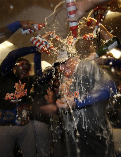 "<div class=""meta image-caption""><div class=""origin-logo origin-image ap""><span>AP</span></div><span class=""caption-text"">New York Mets manager Terry Colllins is doused with champagne and beer in the clubhouse. (AP)</span></div>"