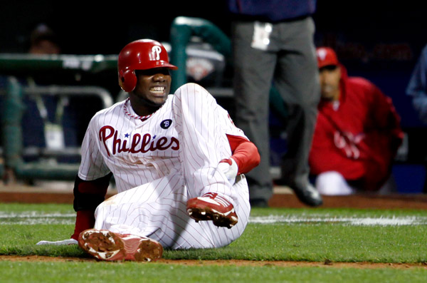 "<div class=""meta image-caption""><div class=""origin-logo origin-image ap""><span>AP</span></div><span class=""caption-text"">Ryan Howard reacts after falling down injured on his way to first base as he makes the last out during the ninth inning of NLDS Game 5 with the St. Louis Cardinals, Oct. 7, 2011. (AP Photo/Alex Brandon)</span></div>"