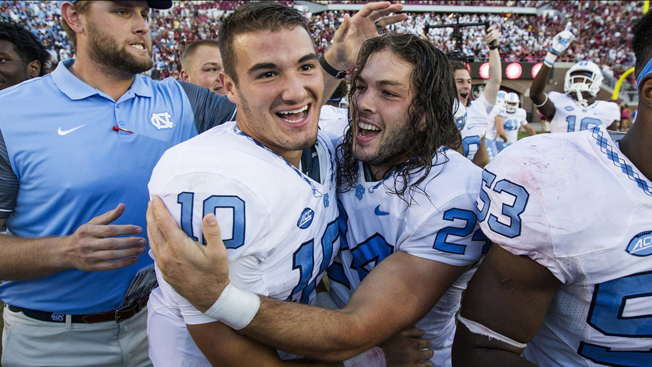 North Carolina kicker Nick Weiler, center, celebrates his game winning field goal with quarterback Mitch Trubisky after defeating Florida State 37-35