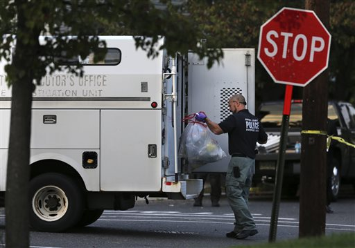 "<div class=""meta image-caption""><div class=""origin-logo origin-image none""><span>none</span></div><span class=""caption-text"">A police officer from the Camden County Prosecutor's Office loads an evidence bag into a van outside a small apartment building. (AP)</span></div>"