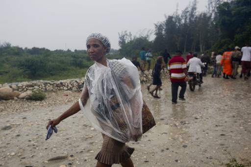 <div class='meta'><div class='origin-logo' data-origin='AP'></div><span class='caption-text' data-credit='Dieu Nalio Chery'>A woman protects herself from the rain with a piece of plastic prior the arrival of Hurricane Matthew, in Tabarre, Haiti, Monday, Oct. 3, 2016</span></div>