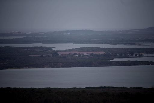 <div class='meta'><div class='origin-logo' data-origin='AP'></div><span class='caption-text' data-credit='Ramon Espinosa'>An overcast sky hangs over the Guantanamo Bay U.S. Naval Base before the arrival of Hurricane Matthew from in the village Paraguay, Guantanamo, Cuba, Monday, Oct. 3, 2016,</span></div>