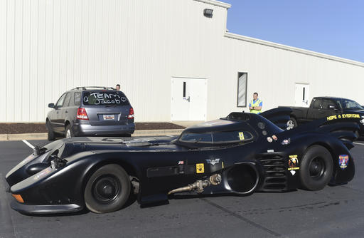 <div class='meta'><div class='origin-logo' data-origin='none'></div><span class='caption-text' data-credit='AP Photo/Rainier Ehrhardt'>A Batmobile arrives before a superhero-themed funeral service for Jacob Hall.</span></div>