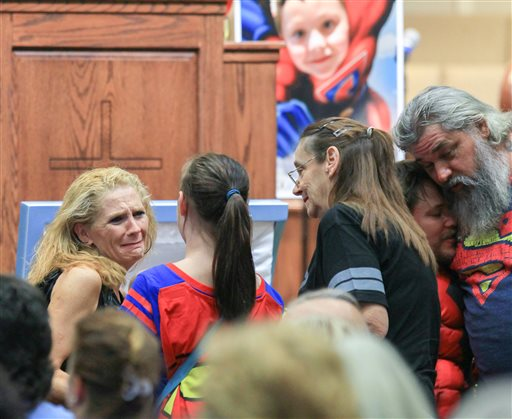 <div class='meta'><div class='origin-logo' data-origin='none'></div><span class='caption-text' data-credit='Ken Ruinard/The Independent-Mail via AP, Pool'>Renae Hall, left, mother of Jacob Hall, talks to Starr Henderson, 12, of Belton, S.C., during a wake service for Jacob Hall</span></div>