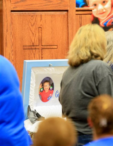 <div class='meta'><div class='origin-logo' data-origin='none'></div><span class='caption-text' data-credit='Ken Ruinard/The Independent-Mail via AP, Pool'>Friends and family pay their respect during a wake service for Jacob Hall at Oakdale Baptist Church in Townville, S.C.</span></div>