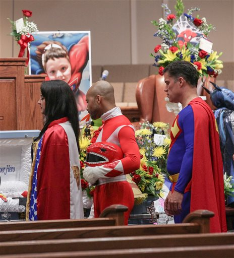 <div class='meta'><div class='origin-logo' data-origin='none'></div><span class='caption-text' data-credit='Ken Ruinard/The Independent-Mail via AP, Pool'>Katie Olvera, dressed as Wonder Woman, Aaron Sloan, dressed as a Power Ranger, and John Suber, dressed as Superman, pay their respects during a wake service for Jacob Hall</span></div>