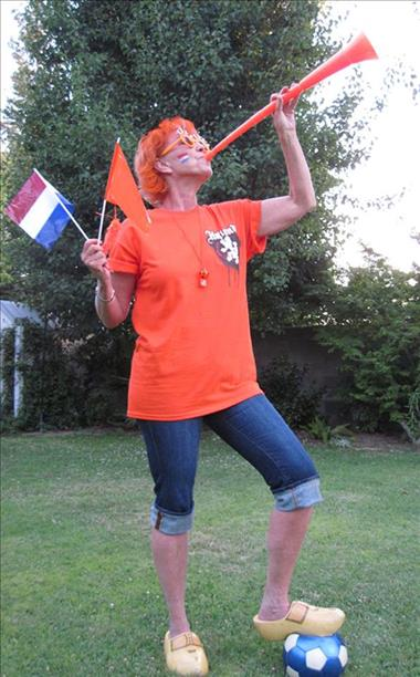 "<div class=""meta image-caption""><div class=""origin-logo origin-image ""><span></span></div><span class=""caption-text"">Go Holland!  Keep sending in your World Cup fan photos! (photo submitted via uReport)</span></div>"