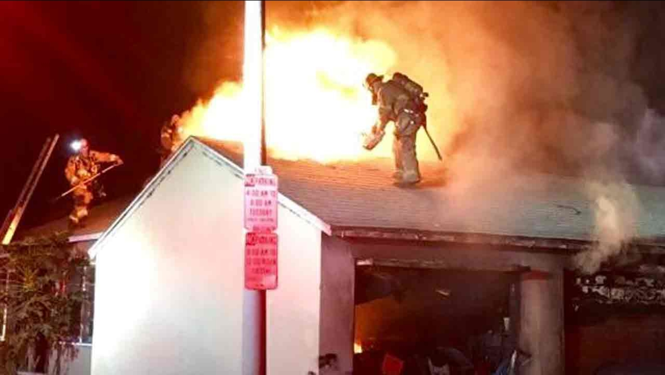 Long Beach Fire Department crews battle an apartment fire early Friday, Oct. 7, 2016.