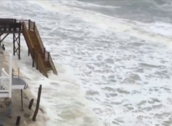 "<div class=""meta image-caption""><div class=""origin-logo origin-image ""><span></span></div><span class=""caption-text"">Waves come dangerously close to beach homes on Oak Island (ABC11 iWitness Photo)</span></div>"