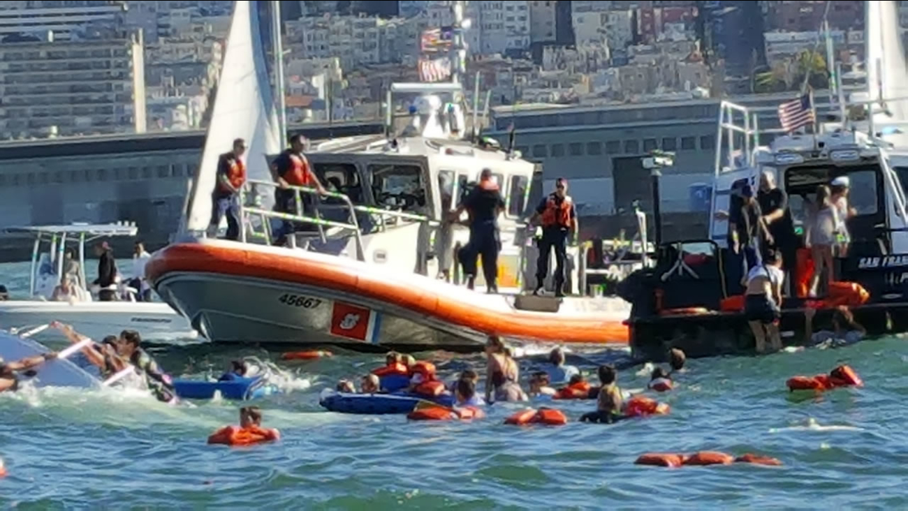 This image shows a rescue operation underway after a sailboat capsized in the San Francisco Bay near Pier 45 on Oct. 8, 2016.