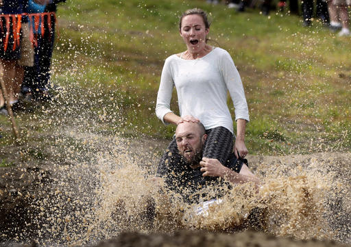<div class='meta'><div class='origin-logo' data-origin='AP'></div><span class='caption-text' data-credit='AP Photo/Robert F. Bukaty'>Peter Ver Ploeg carries Virginia Petrovek through the mud pit during the North American Wife Carrying Championship, Saturday, Oct. 8, 2016, at the Sunday River Ski Resort.</span></div>