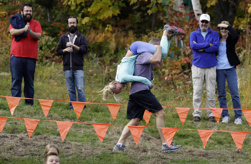 <div class='meta'><div class='origin-logo' data-origin='AP'></div><span class='caption-text' data-credit='AP Photo/Robert F. Bukaty'>Henry Tabur carries Kim Joyce, both of Pembroke, Mass., while racing in the North American Wife Carrying Championship, Saturday, Oct. 8, 2016, at the Sunday River Ski Resort.</span></div>