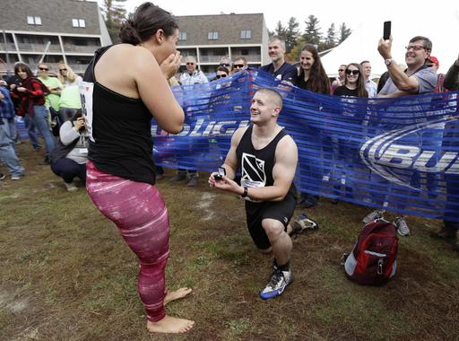 <div class='meta'><div class='origin-logo' data-origin='AP'></div><span class='caption-text' data-credit='AP Photo/Robert F. Bukaty'>Alex Gauvin proposes to his girlfriend Casey Maynard, both of Westbrook, Maine, after completing the 278-yard obstacle course at the North American Wife Carrying Championship.</span></div>