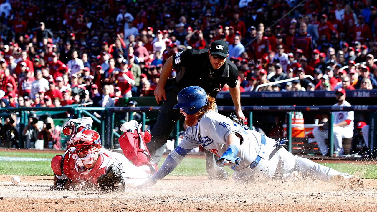 Dodgers' Justin Turner is safe at home when Nationals catcher Jose Lobaton can't hang onto the ball in Game 2 of the NLDS on Sunday, Oct. 9, 2016 in Washington.