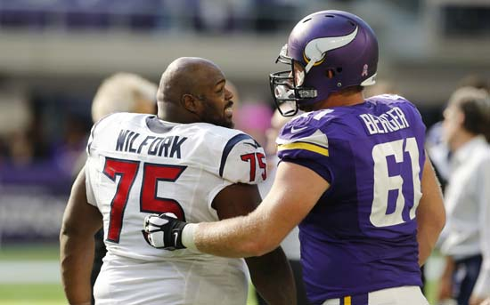<div class='meta'><div class='origin-logo' data-origin='AP'></div><span class='caption-text' data-credit='Jim Mone'>Houston Texans nose tackle Vince Wilfork, left, talks with Minnesota Vikings center Joe Berger, right, after an NFL football game.</span></div>