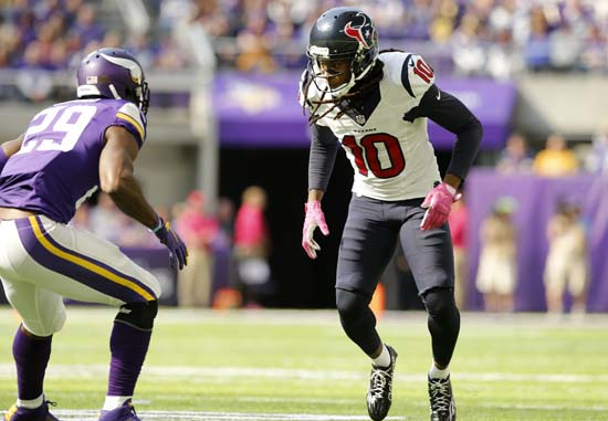 <div class='meta'><div class='origin-logo' data-origin='AP'></div><span class='caption-text' data-credit='Jim Mone'>Houston Texans wide receiver DeAndre Hopkins, right, runs a pass route around Minnesota Vikings cornerback Xavier Rhodes, left, during the first half.</span></div>