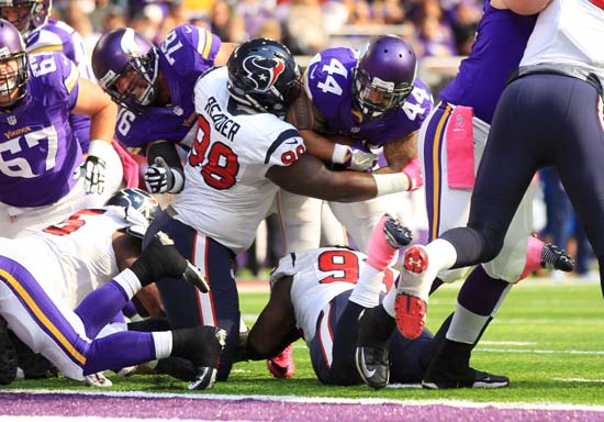 <div class='meta'><div class='origin-logo' data-origin='AP'></div><span class='caption-text' data-credit='Andy Clayton-King'>Minnesota Vikings running back Matt Asiata (44) tries to break a tackle by Houston Texans nose tackle D.J. Reader (98) during a 1-yard touchdown run in the first half.</span></div>