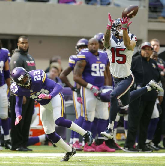 <div class='meta'><div class='origin-logo' data-origin='AP'></div><span class='caption-text' data-credit='Jim Mone'>Houston Texans wide receiver Will Fuller, right, tries to make a reception in front of Minnesota Vikings cornerback Terence Newman (23) during the second half.</span></div>