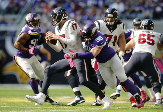 <div class='meta'><div class='origin-logo' data-origin='AP'></div><span class='caption-text' data-credit='Jim Mone'>Minnesota Vikings defensive end Brian Robison (96) tries to tackle Houston Texans quarterback Brock Osweiler (17) during the second half.</span></div>